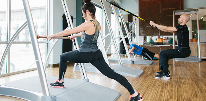 Man and woman working out on SpeedFit and TRX equipment in Fitness Center Gym at INVIVO Wellness Milwaukee