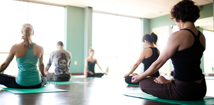 Students practice Meditation in the Yoga Studio at INVIVO Wellness Milwaukee