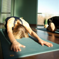 woman practicing yoga doing child's pose at Invivo Wellness